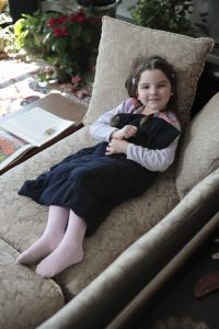 Child With Weighted Blanket By Grampa's Garden - Weighted Comfort Solutions